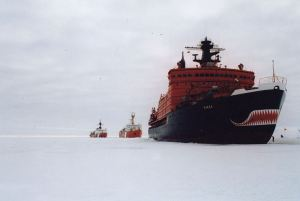 CCGS Lois St. Laurent flanked by a Russian nuclear icebreaker NS Yamal (near, right) and a USCGC Polar Sea